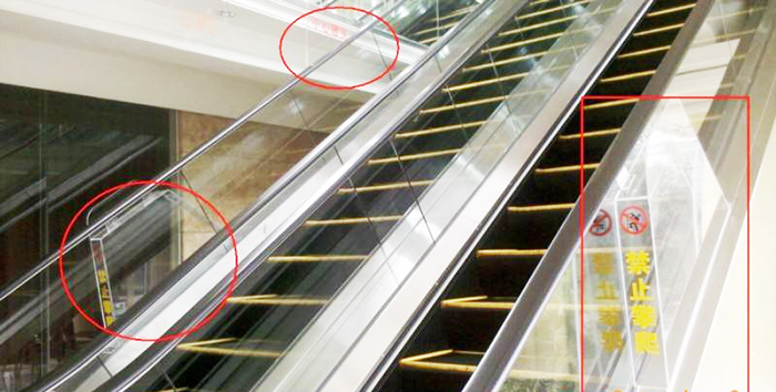What is the escalator anti-climbing device?